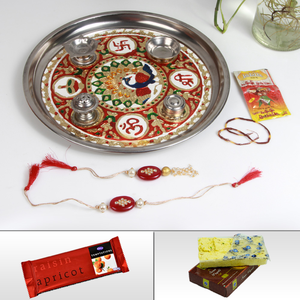 Online rakhi for bhaiya bhabhi with pooja thali, sweets and chocolates