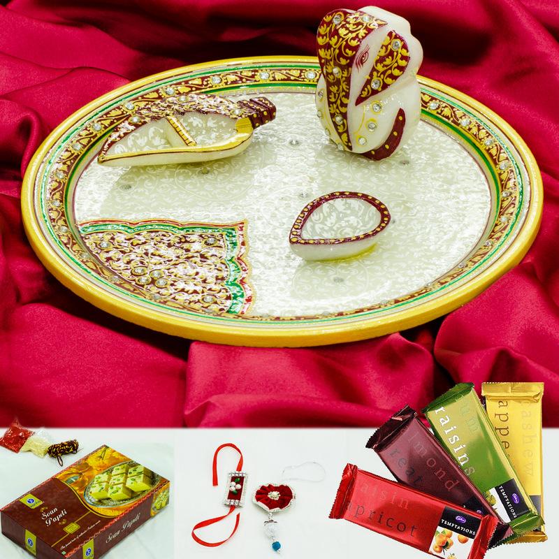 Rakhi online buy with ethnic marble pooja thali, embossed ganesh, sweets and chocolates