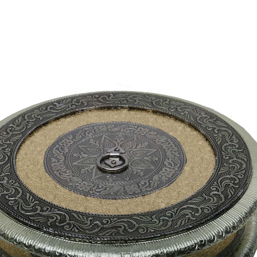 A beautifully designed round dry fruit box with a push in lid. - beautifully designed round dry fruit box