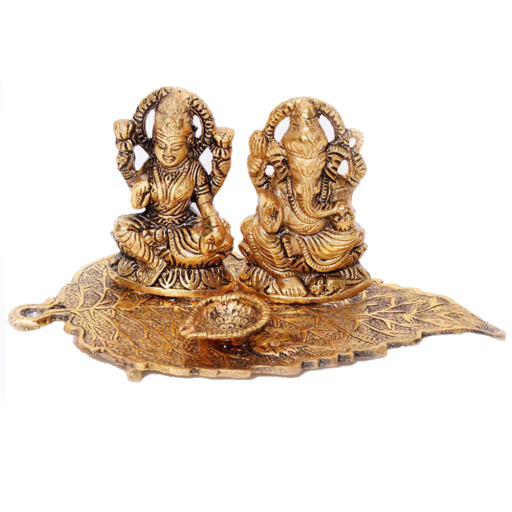 Metal Laxmi & Ganesha Idol on a leaf for Sale