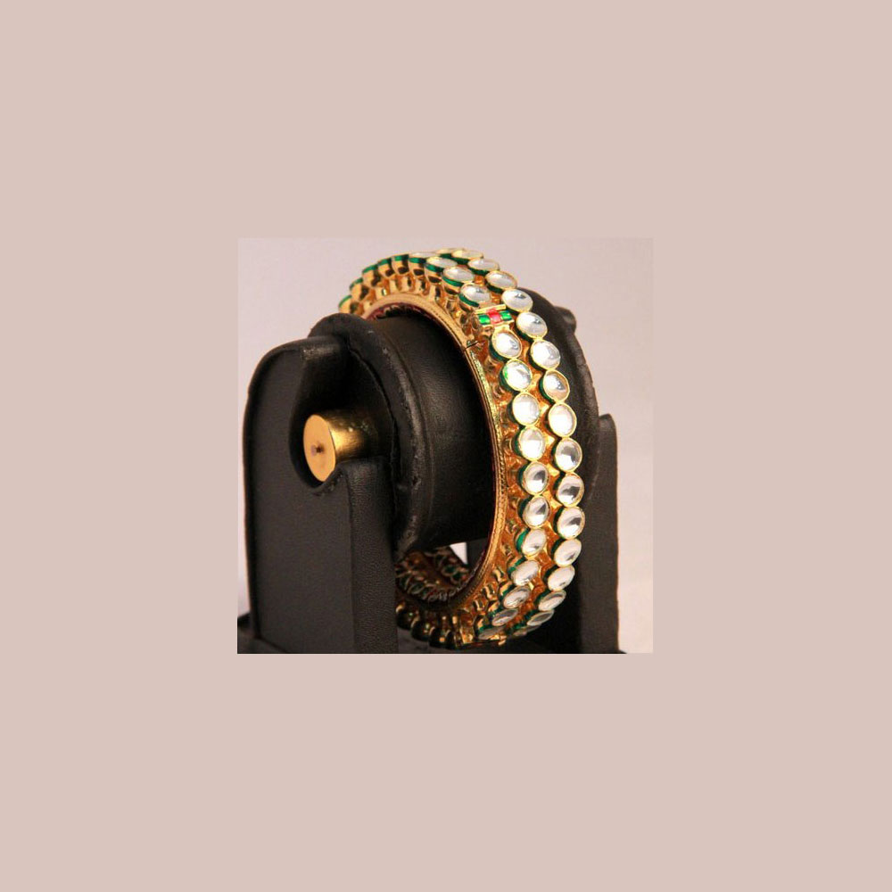 Slightly green shaded kundan bangles