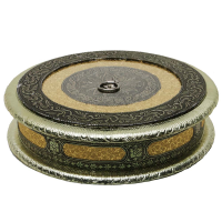 A beautifully designed round dry fruit box with a push in lid.