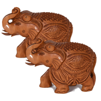 A pair of elephants carved out of wood with beautiful engravings