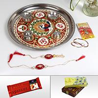 Online rakhi for bhaiya bhabhi with pooja thali, sweets and chocolates